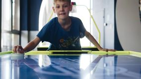 Father and son play air hockey in the entertainment center. The views of the child. Entertainment and emotions stock footage