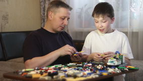 Father and son play blocks. To work with children. stock video footage