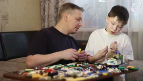 Father and son play blocks. To work with children. stock footage