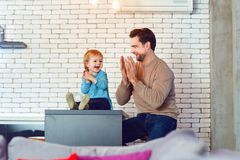 Father and son play fun together indoors. Father`s Day stock photography