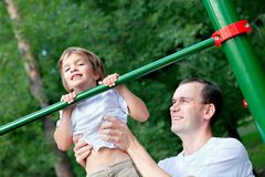 Father and son play sports Stock Photos