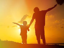 Father and son play at sunset beach Royalty Free Stock Photo