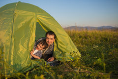 Father and son play in tent Stock Photo