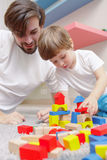Father and son play together Royalty Free Stock Photo