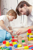 Father and son play together Royalty Free Stock Photography
