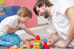 Father and son play together Stock Photos