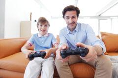 Father and son play video game Royalty Free Stock Image