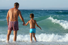 Father and son play in water Royalty Free Stock Photo