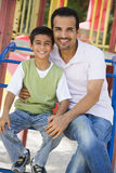 Father and son in playground Stock Image