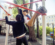 Father with son on playground training, happy family smiling outside, lifestyle people concept Stock Photos