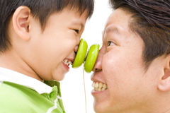 Father and son playing. Closeup of an Asian father and son playing together and rubbing noses Stock Images