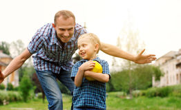Father and son playing. Together at the park Royalty Free Stock Photos