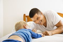 Father and son playing. stock photos
