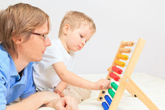 Father and son playing with abacus Stock Photos