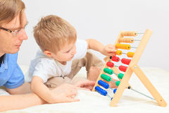 Father and son playing with abacus Royalty Free Stock Photo