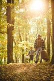 Father and son playing in the autumn forest. Father and son walking together in the park, fall day. Man with beard, dad. With young son in autumn park stock photos