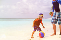 Father and son playing ball at beach Royalty Free Stock Images
