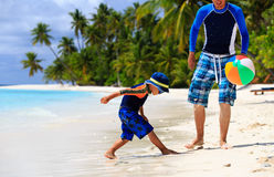 Father and son playing ball at beach Royalty Free Stock Image