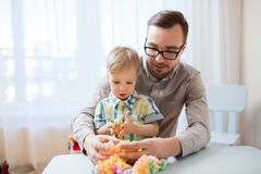 Father and son playing with ball clay at home Royalty Free Stock Photo