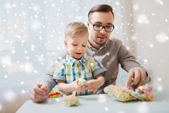 Father and son playing with ball clay at home Royalty Free Stock Photography