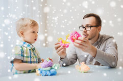 Father and son playing with ball clay at home Royalty Free Stock Photos