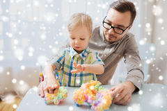Father and son playing with ball clay at home Royalty Free Stock Image