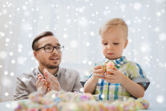 Father and son playing with ball clay at home Stock Images