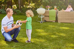 Father and son playing ball Royalty Free Stock Image