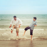 Father and son playing with a ball Stock Image