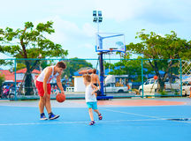 Father and son playing basketball on sport ground Royalty Free Stock Photo
