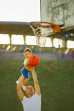 Father and son playing basketball Stock Images