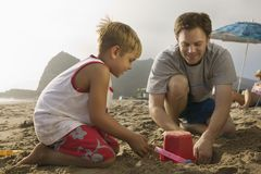 Father and Son Playing at Beach Royalty Free Stock Photo