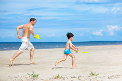 Father and son playing on the beach Royalty Free Stock Images