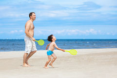 Father and son playing on the beach Stock Image