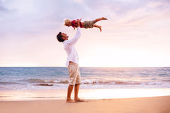 Father and Son Playing. On the Beach stock photo