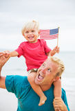 Father and son playing on the beach. With American flag. USA celebrate 4th of July Royalty Free Stock Photos