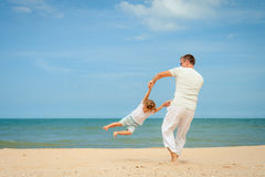 Father and son playing at the beach. At the day time Royalty Free Stock Photo
