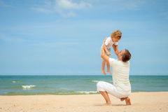 Father and son playing at the beach Royalty Free Stock Image