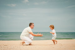 Father and son playing at the beach. At the day time Stock Image