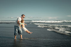 Father and son playing on the beach Stock Photos