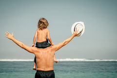 Father and son playing on the beach. At the day time Stock Photography