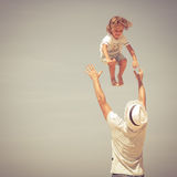 Father and son playing on the beach. At the day time Stock Images