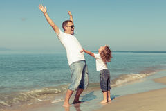 Father and son playing on the beach at the day time. Royalty Free Stock Images