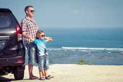 Father and son playing on the beach at the day time. Royalty Free Stock Photo