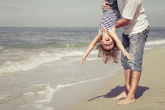 Father and son playing on the beach at the day time. royalty free stock photos