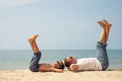 Father and son playing on the beach at the day time. Royalty Free Stock Photography