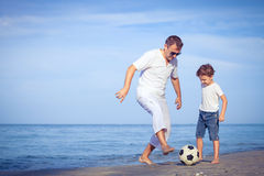 Father and son playing on the beach at the day time. Stock Photography