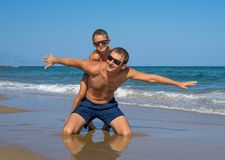 Father and Son Playing on the Beach, Having Quality Family Time Together. Greece. stock photography