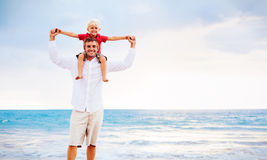 Father and Son Playing. On the Beach by the Ocean royalty free stock photo