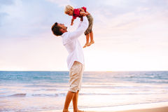 Father and Son Playing. On the Beach by the Ocean Royalty Free Stock Photos